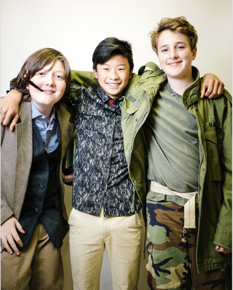 J.R.R.Tolkien, Nelson Mandela, and Ché Guevara (aka 8th graders Oak, Kaelen, and Ezra) celebrated their completed Biography Fair projects in the portrait studio set up by parent and professional photographer Sean Markey last Friday.
