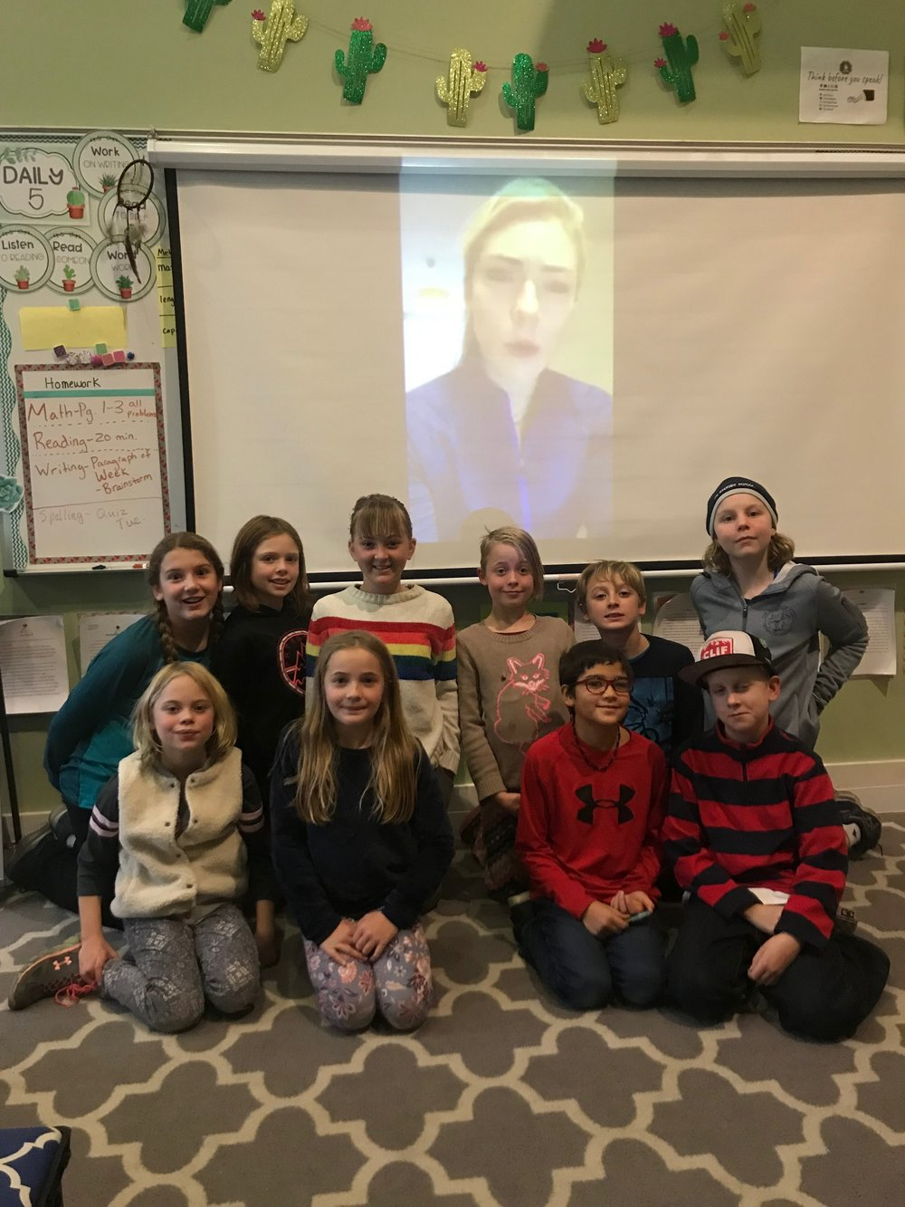 Riverside 4th grade students watch Mikaela Shiffrin's live Facebook feed from Europe as part of the school's Biography Fair. Pictured are front (l-r) Molly Aeberbard, Esme Cobb, Kingston Newell, Sylvan Balcom, and back (l-f) Gabi Young, Sofia Bunnell, Brooklynn Hibshman, Pearl Arberbard, Lyric Golden, and Julia Spence.