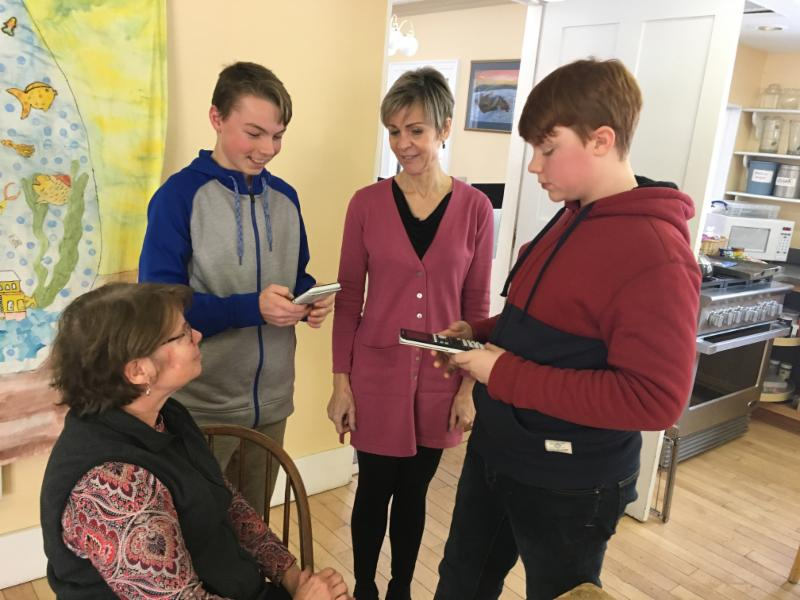 7th and 8th graders and Algebra 1 students Colter Thibaudeau and Ethan Spence showed off their new graphing calculators to Suzanne and Michelle during their lunch break today.