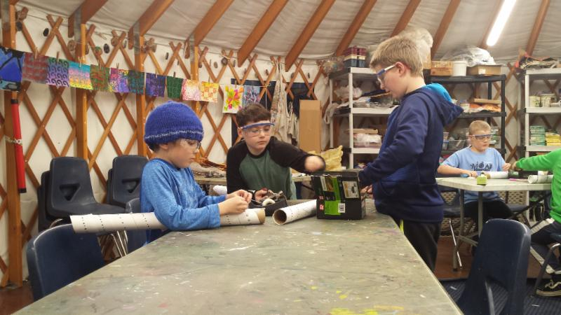 3rd graders Kellan, Gabe, and Quinn have been making rain sticks in music class from scratch.