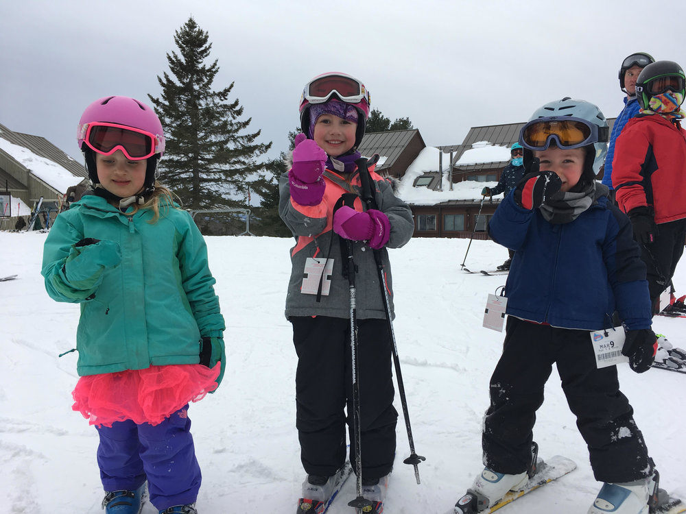 Skiing was easier than figuring out how to give a thumbs-up with your mitten on for these preschoolers last week: Mabel, KendaLyn, and Henry.