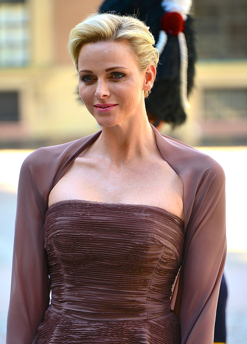 Princess Charlene - Charlene Wittstock was born in what was then Rhodesia (now Zimbabwe) on January 25, 1978, to Michael and Lynette Wittstock. She has two younger brothers: Gareth and Sean. Raised in South Africa, Charlene was a competitive swimmer on the South African National Team and won several national titles. She married Prince Albert of Monaco on July 1 (civil) and 2 (religious), 2011, in Monaco. They have twins born in 2014: Princess Gabriella and Prince Jacques.She now holds the title The Princess of Monaco.(Photo: Frankie Fouganthin/Wikimedia Commons)