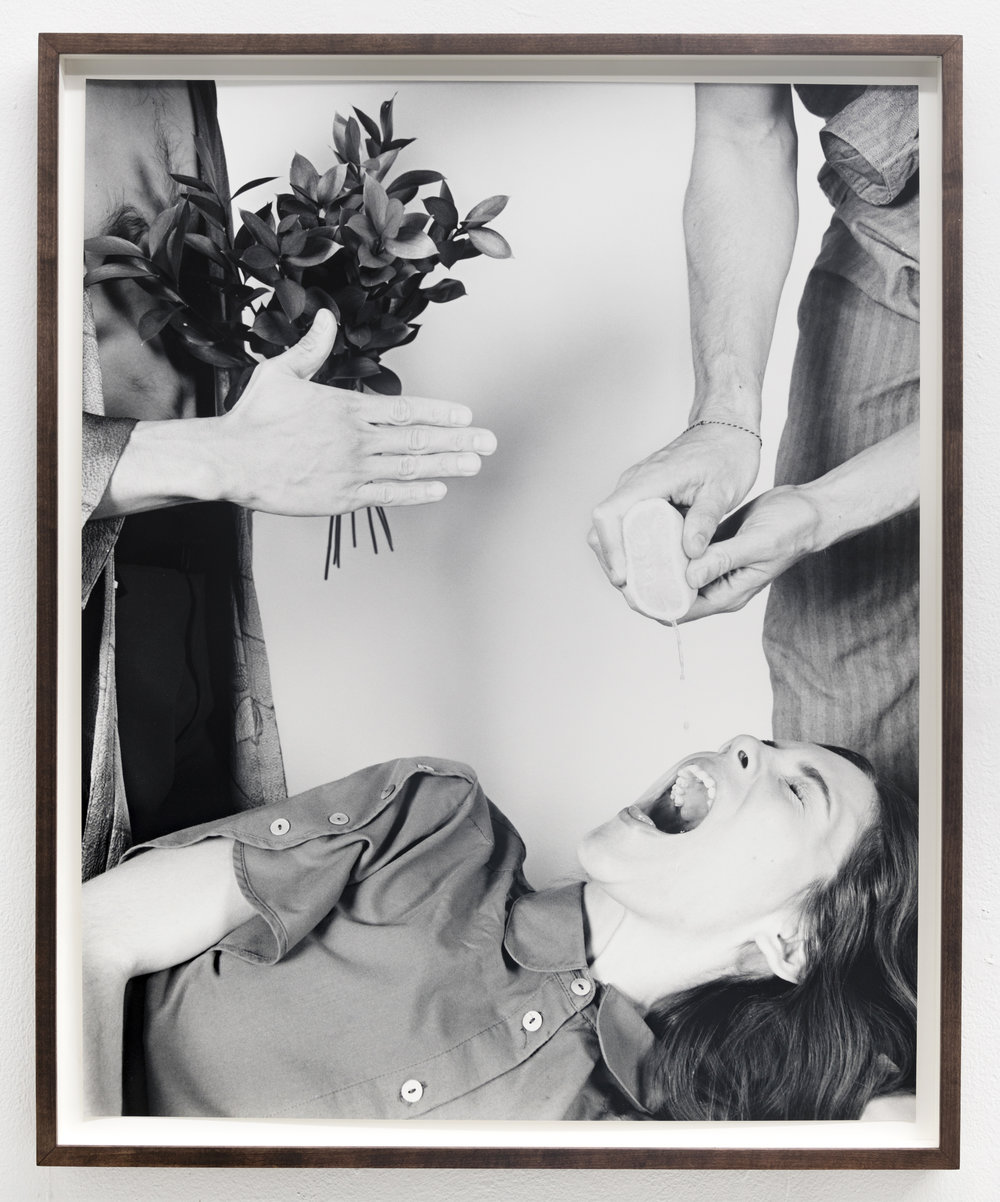 Hand Squeezing Lemon into Open Mouth, Onlooker (Greyscale) , 2018, gelatin silver print, 30 x 24 inches