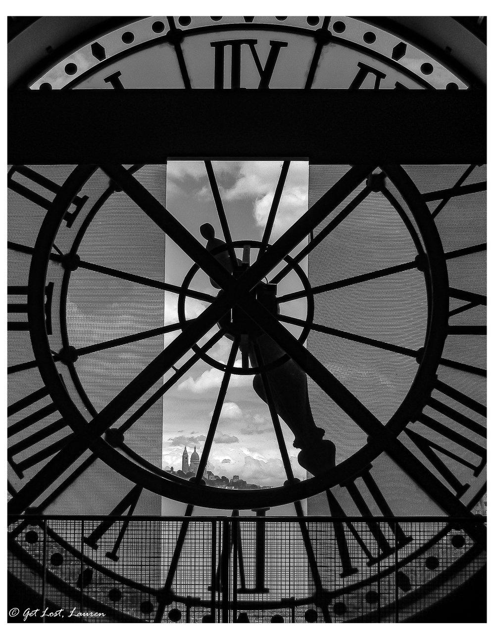 The Sacre Coeur peeking through the clock at the Orsay.