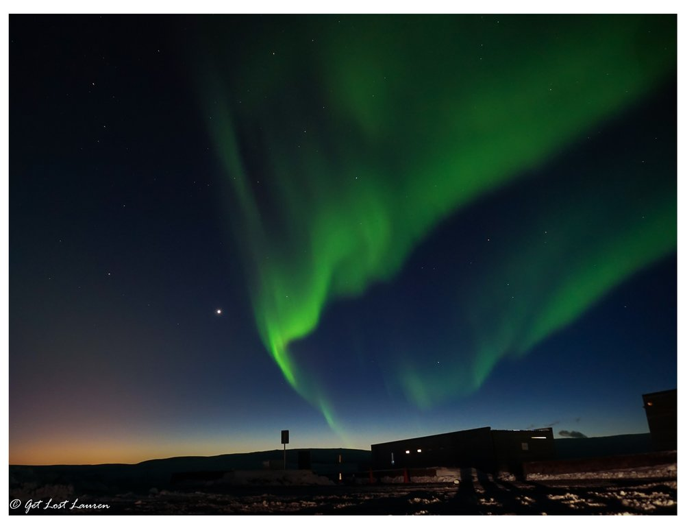 Northern Lights over Þingvellir Visitor Center with the glow from the lights of Reykjavik. Sony a5000, f4/ISO 800/4""