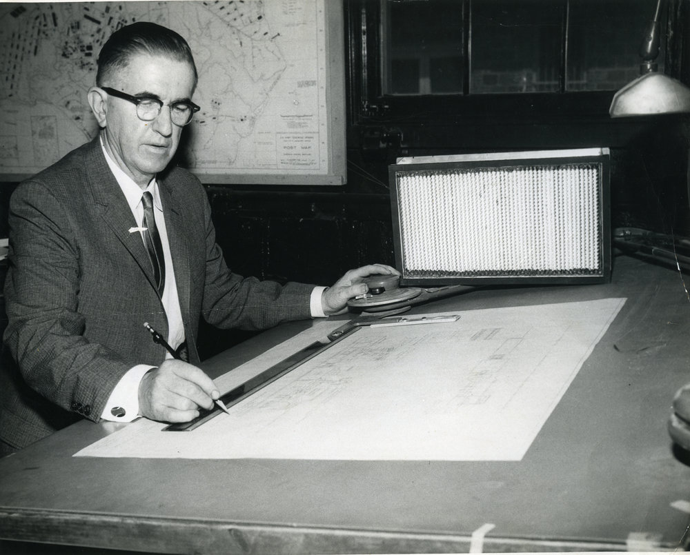 Stuart at his desk. 1963