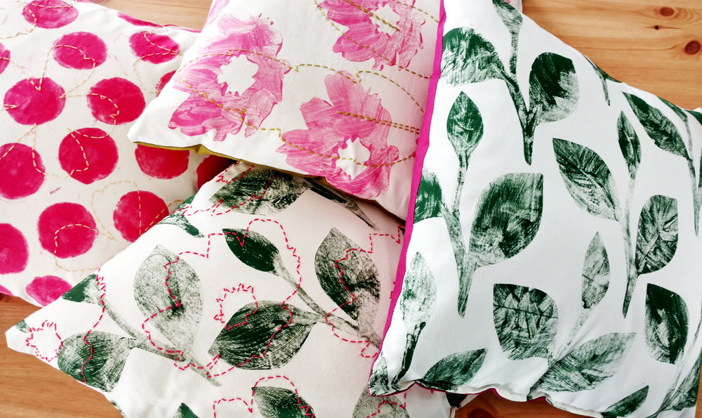 Monoprinted and embroidered pillows.