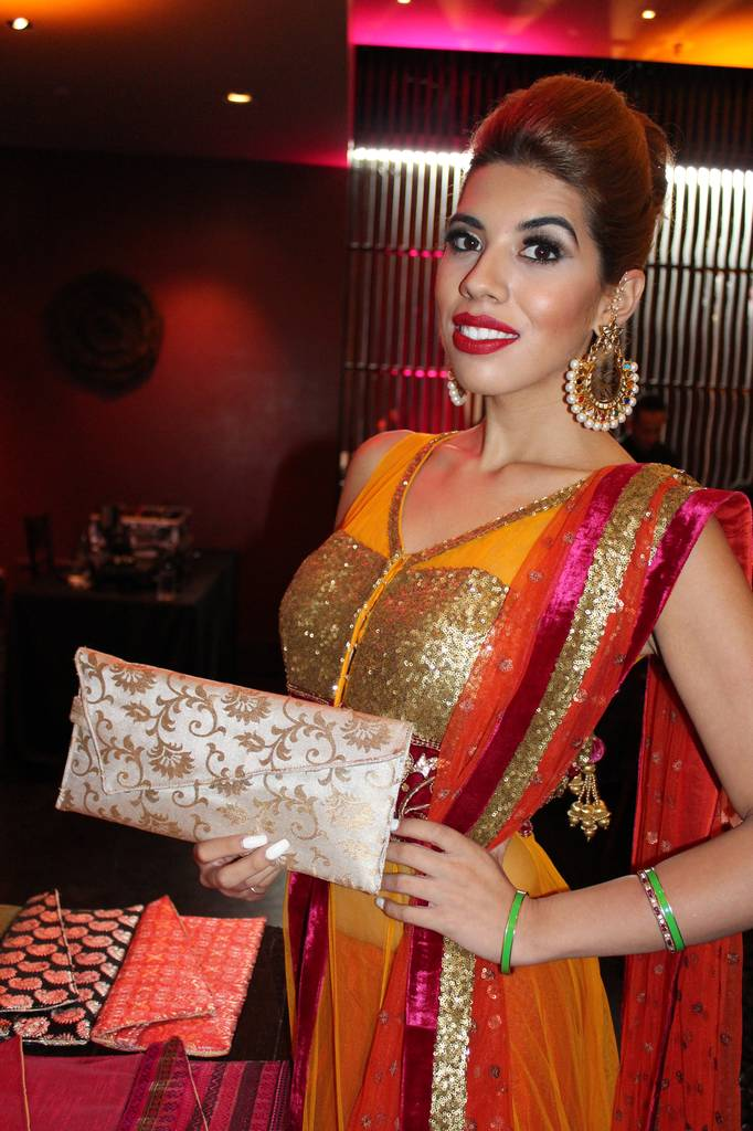 Model Lasy with rHope Clutch made by the women of Chhoti Si Asha