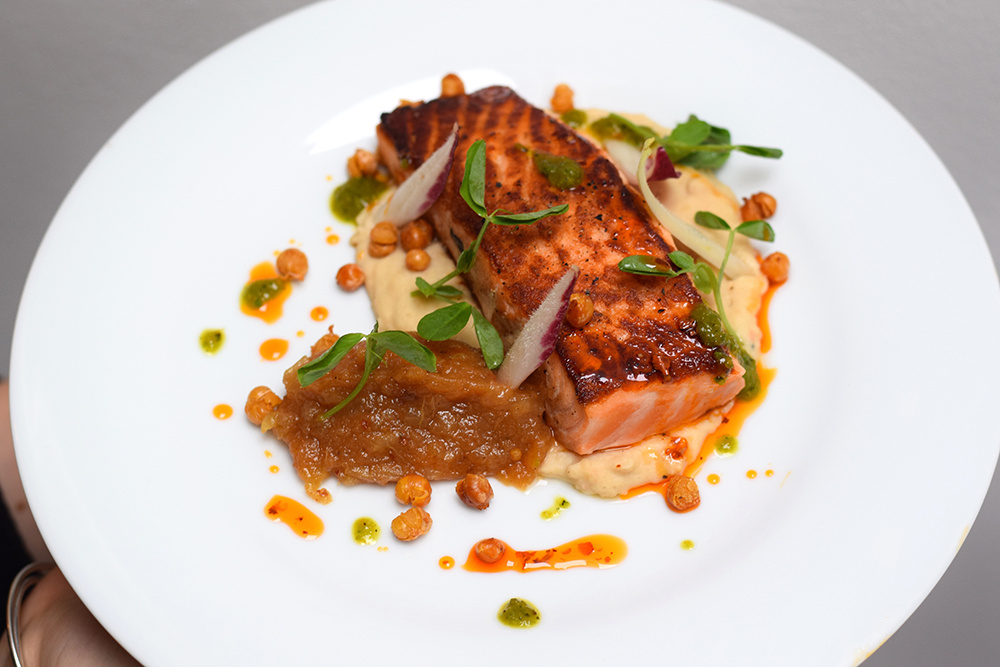 Pan roasted salmon, crispy paprika pork skin, white bean puree, dukkha spiced apple sauce, crispy chickpeas, red and green chilli and pea shoots