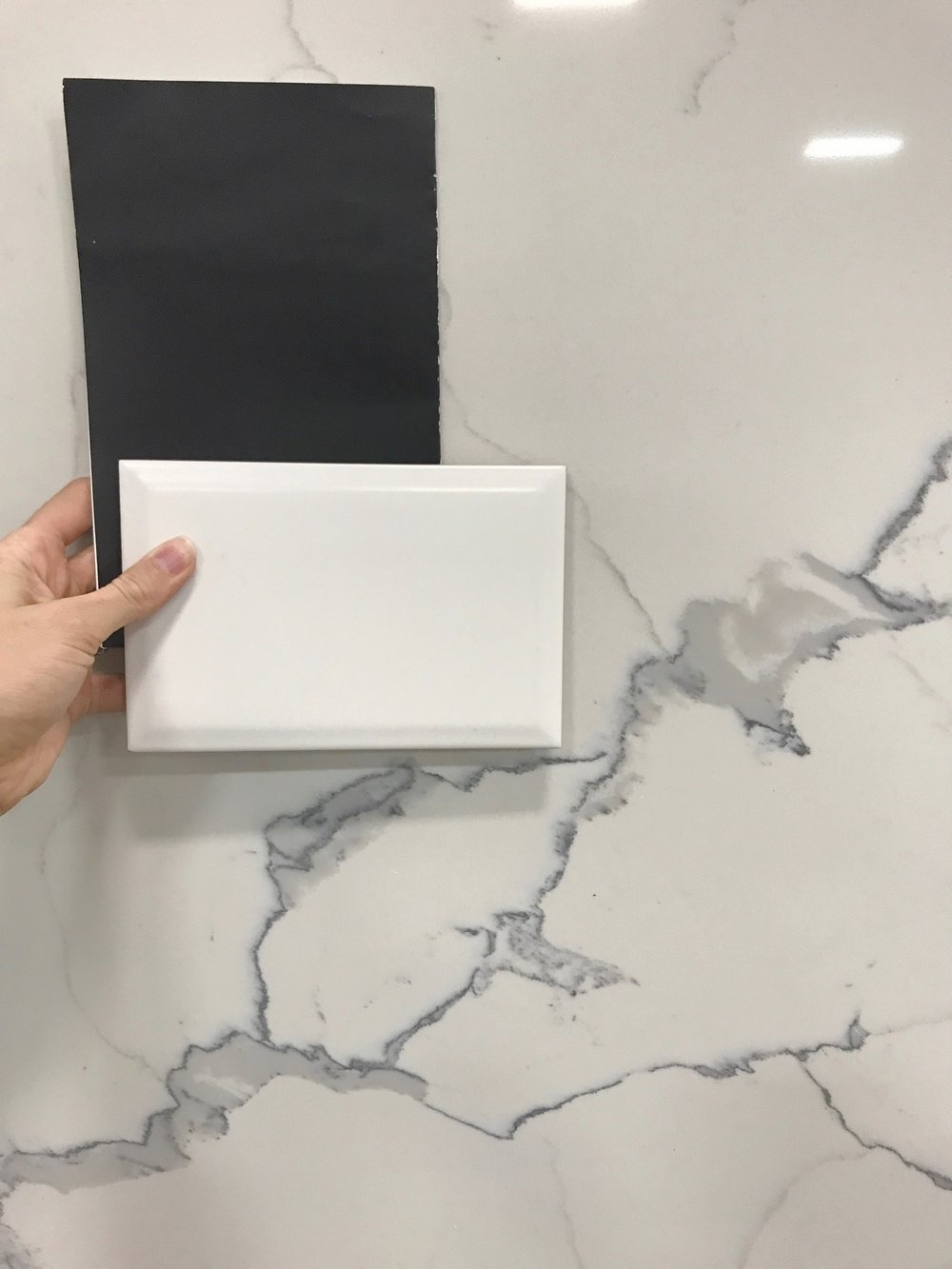 Materials- Cabinetry will be a soft black (although it appears grey here..it's not), beveled matte subway tile and a quartz countertop