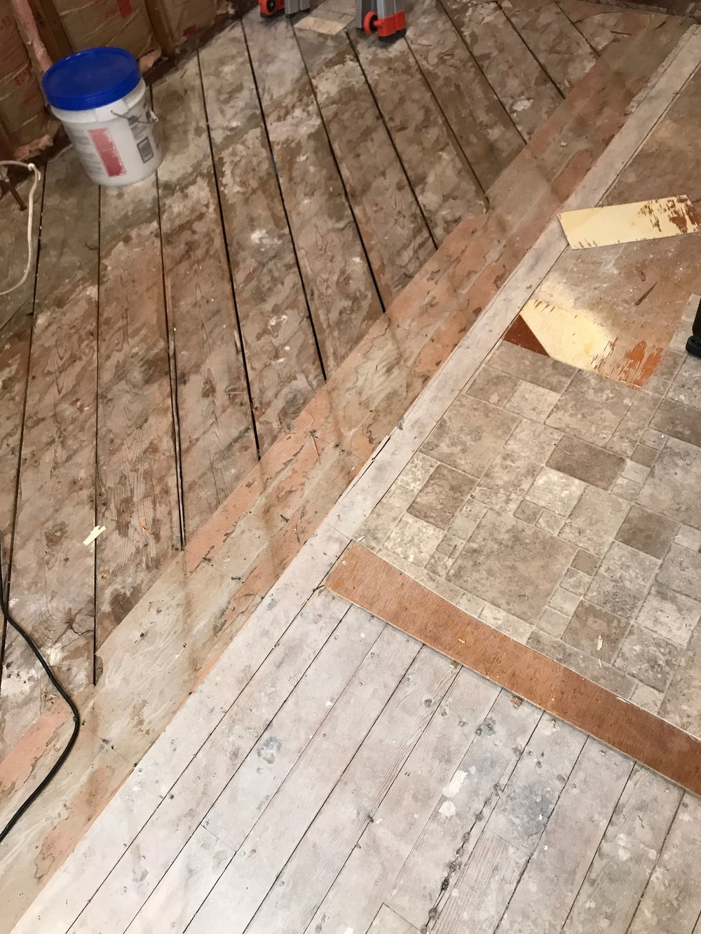 Ripping 3 layers of flooring out (This was a pain in my ass, but the new floors make it so worth it)