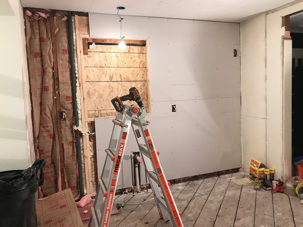 We re-sheetrocked 2 walls and the ceiling, then mudded and taped them.  Tip: Hire this part out, it's very tedious + hard on your body.  I wish I had pictures of the husband and I installing sheetrock on the ceiling (with one ladder at midnight) :)
