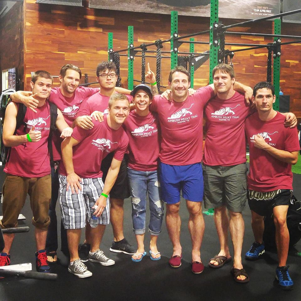 Ambush Muay Thai teammates Spencer Hanley, Sean McKiernan, Jack Hawkins, Paul Gonzales, Jenna Crank, Tim Kennedy, Coach Elton Wells, and Buddy Chambers.
