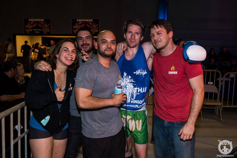 "Ambush Muay Thai teammates Jenna Crank, Roland Rodriguez, Bobby Peek, Sean McKiernan, and Coach Elton Wells. Photo credit to Mike ""The Truth"" Jackson."