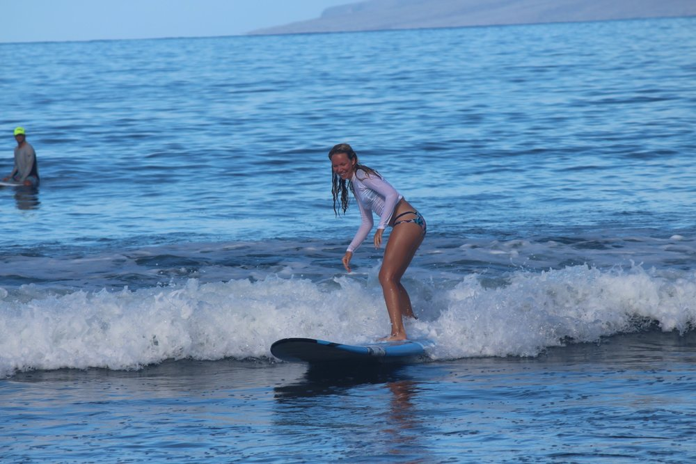 Surfing on Maui is a must do activity! Smiles for miles!