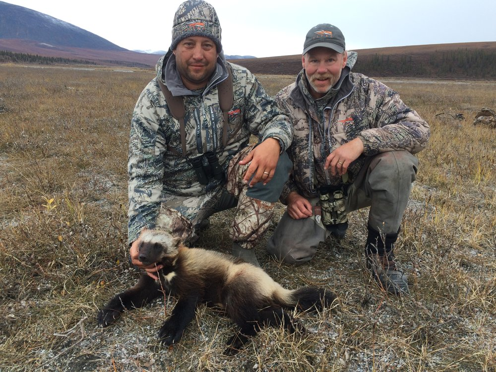 Terry and his guide, Richard, with Terry's wolverine