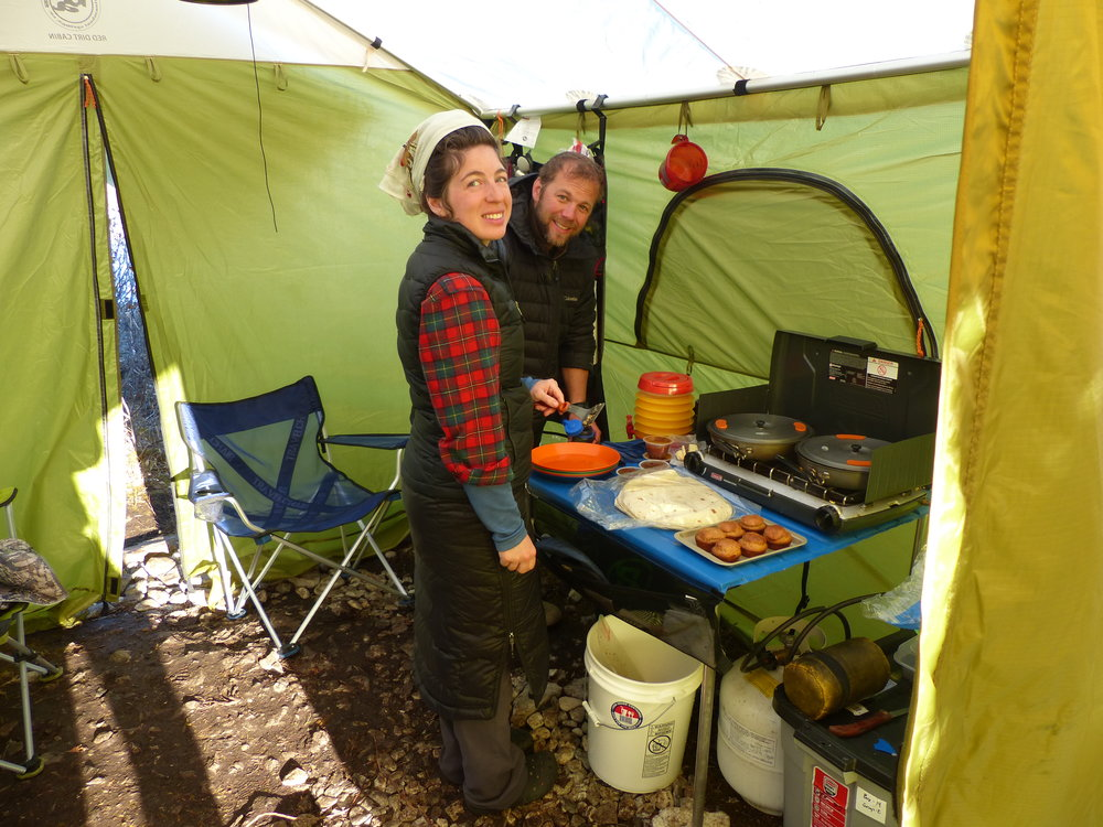 Alexandra and Nate prepare breakfast in the cook tent