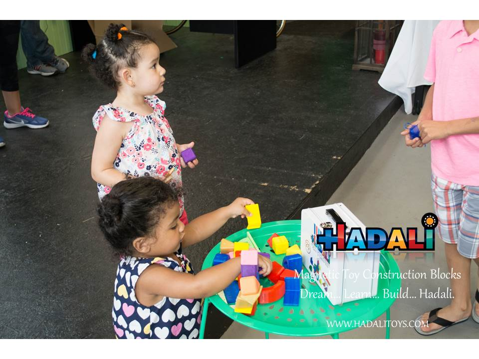 Hadali Toys - Toddler plays with magnetic toy construction blocks.