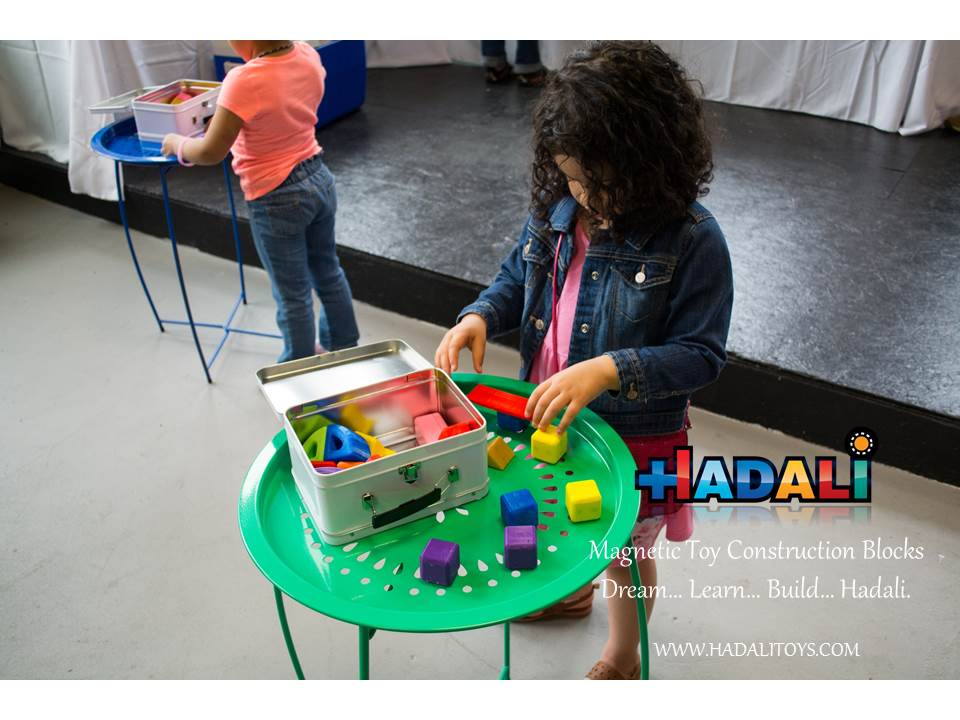 Hadali Toys - Girl opens a Hadali box to uncover its pieces and explore her STEM skills.