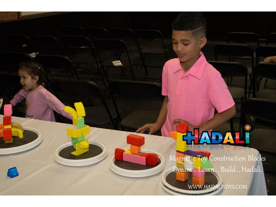 Hadali Toys - Boy Examines Assemblies