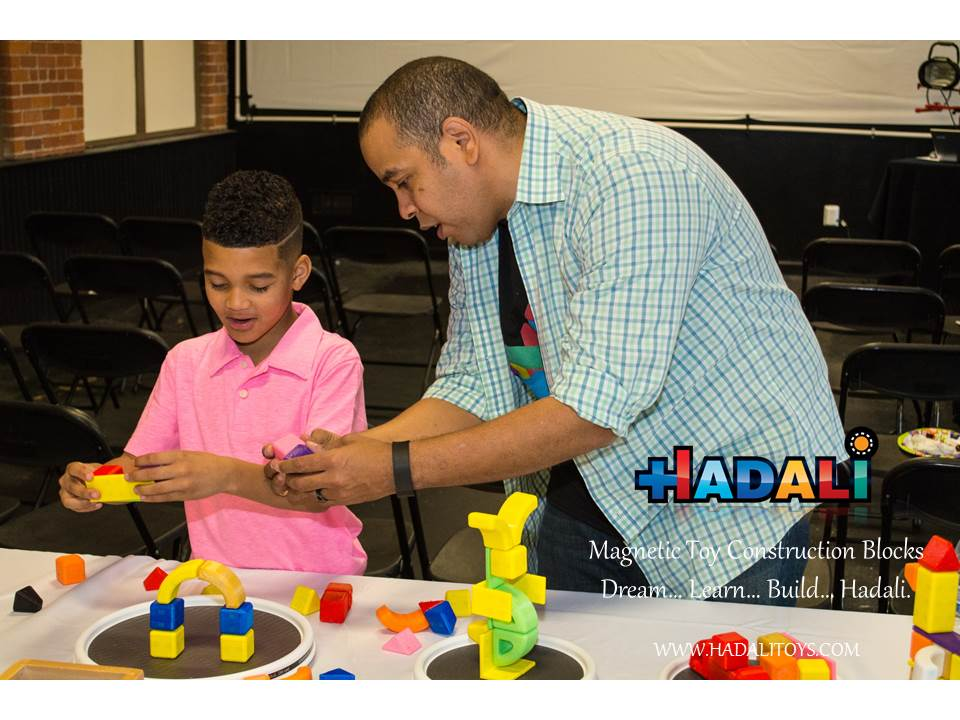 Hadali Toys - Adult teaches child about magnetic polarity.