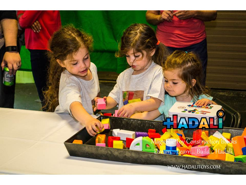 Sisters build together with Hadali blocks.