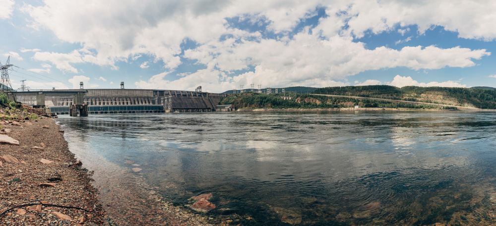 Krasnoyarsk Dam.  A 124-metre (407 ft) high concrete gravity dam located on the Yenisey River about 30 kilometres (19 mi) upstream from Krasnoyarsk in Divnogorsk, Russia. It was constructed from 1956 to 1972 and supplies 6,000 MW of power, mostly used to supply the KrAZ (Krasnoyarsky Aluminievyy Zavod, Krasnoyarsk Aluminum Plant). Both power and aluminum plants are controlled by the RUSAL company. (wikipedia)