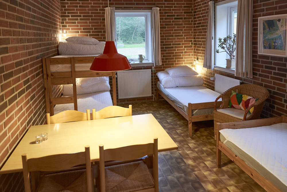 Room 4: Two single beds, to bunk beds and a table