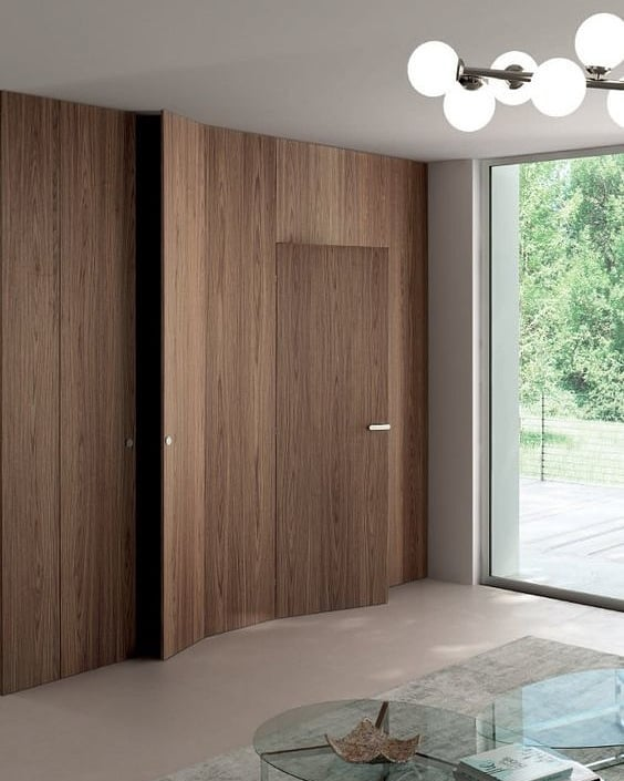 Wall covered in wood veneer with hidden doors. Who doesn't love a secret door? . . . . . Image via Pinterest #bespokejoinery #minimal #design #carpenters #joinery #wood #veneer #hiddendoor #invisibledoor #kitchens #wardrobes  #doors #wallcovering #furniture  #furnituredesign #interior #interiordesign #interiorarchitecture #architecture #luxuryinteriors #luxuryhome #designlovers #homedesign #carpentercyprus