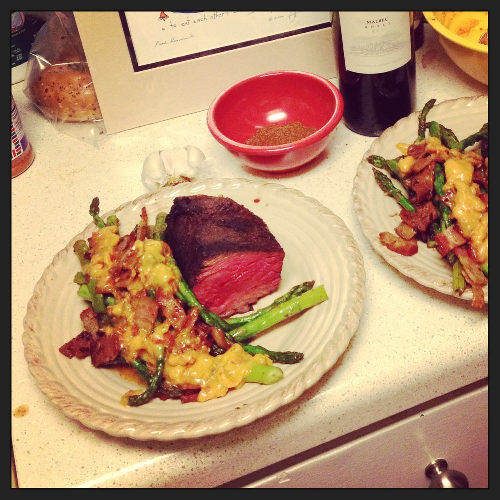 One of our first meals made together as a couple. Beef short ribs rubbed with salt pepper and coffee, and asparagus in a bacon/sun-dried tomato sauce. I was a goner.