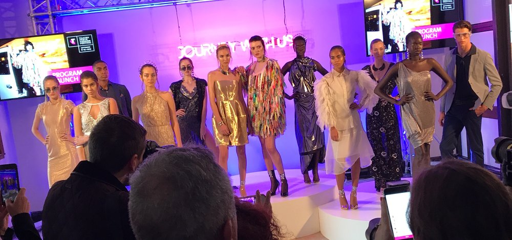 Quick snap from TPFF program launch.  Aluel is wearing our space dress, 5th from the right! x