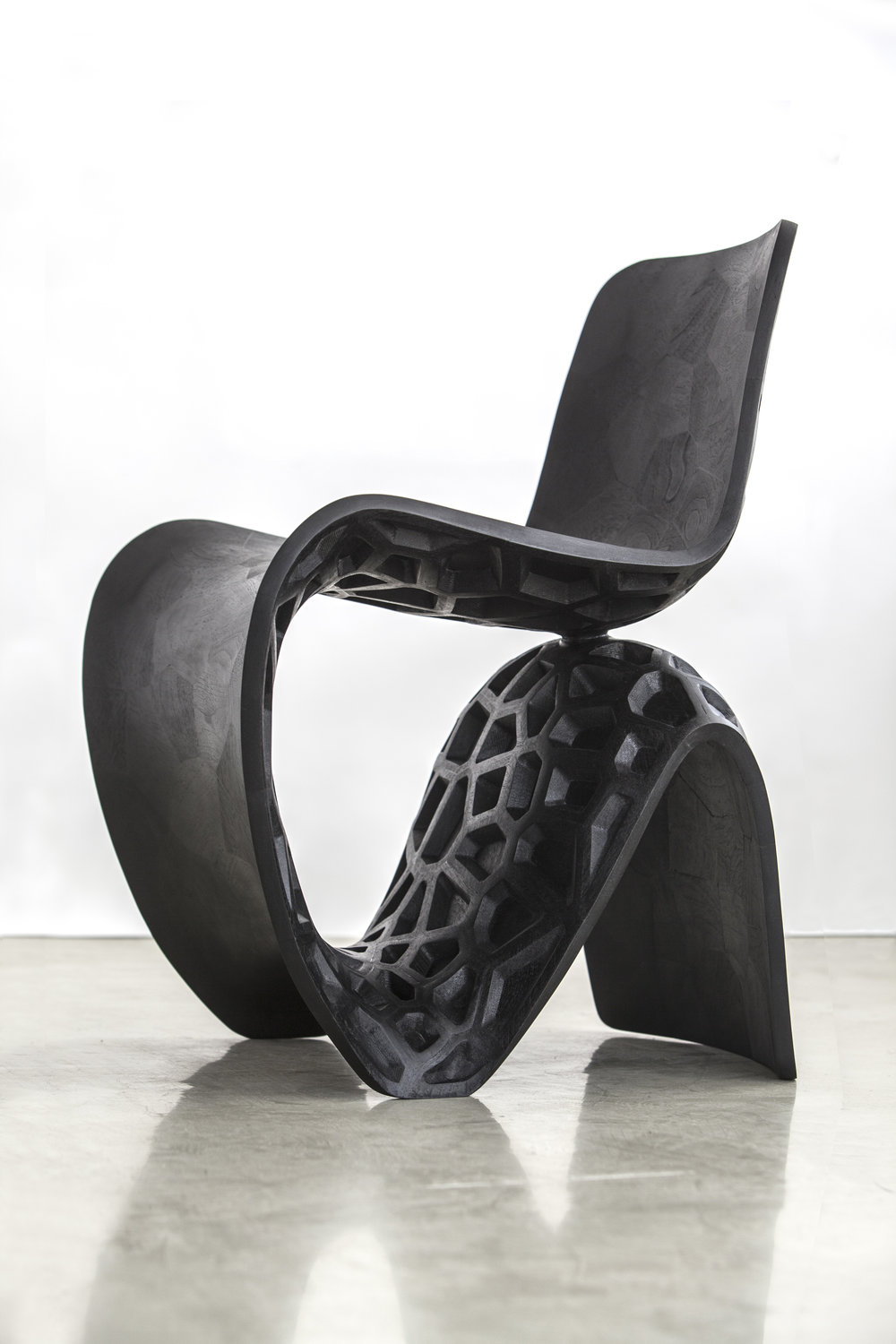Joris Laarman,   Maker Chair (Voronoi) , 2014. Walnut. 30 3/4 x 23 5/8 x 25 1/2 in. Courtesy of the Artist and Friedman Benda, New York. 2016.JL.01. Photo: Friedman Benda, New York  METHOD: Digitally fabricated 3D parts, CNC milling machine