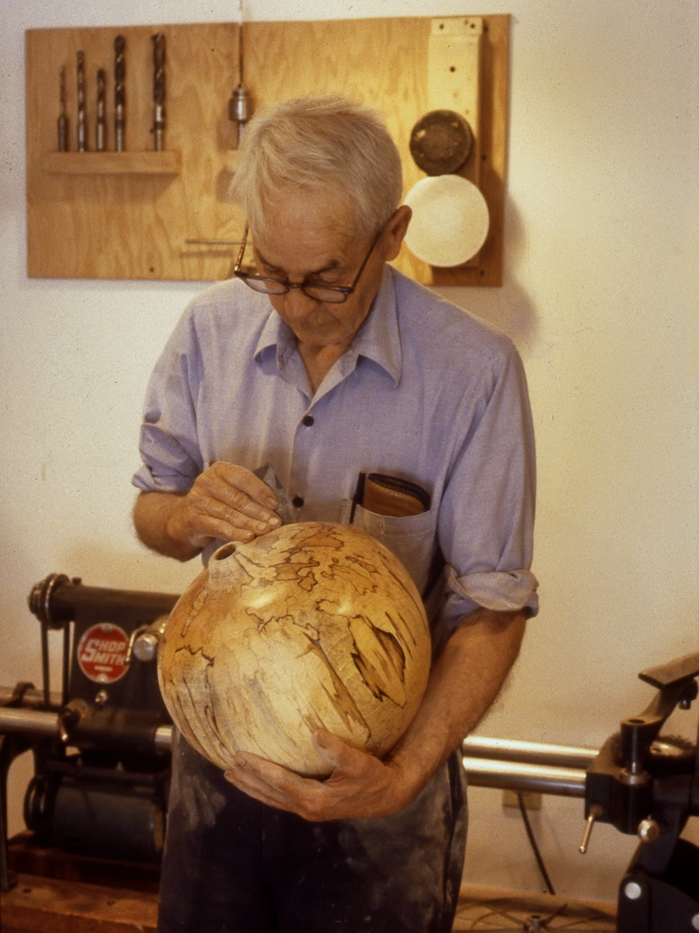 Fig. 19.  Mel Lindquist hand polishes one of his spalted vessels in his Henniker, New Hampshire, studio, 1983. Photo: Lindquist Studios