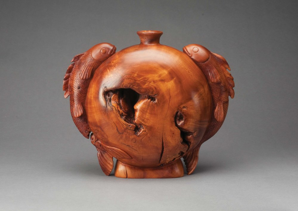 Fig. 24.   Michelle Holzapfel, United States. Fishes Bottle Vase, 1987. Cherry burl. 12 x 14 x 4 1/2 in. Donated by the Artist. The Center for Art in Wood's Museum Collection. OBJ 120. Photo: John Carlano