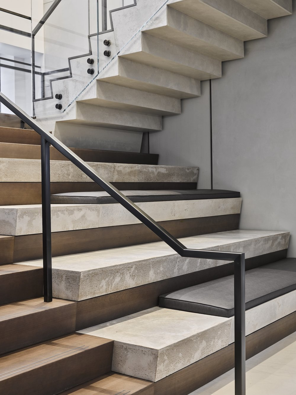 Get Real Surfaces concrete wall panels, concrete stairs, trowel-applied concrete wall finish