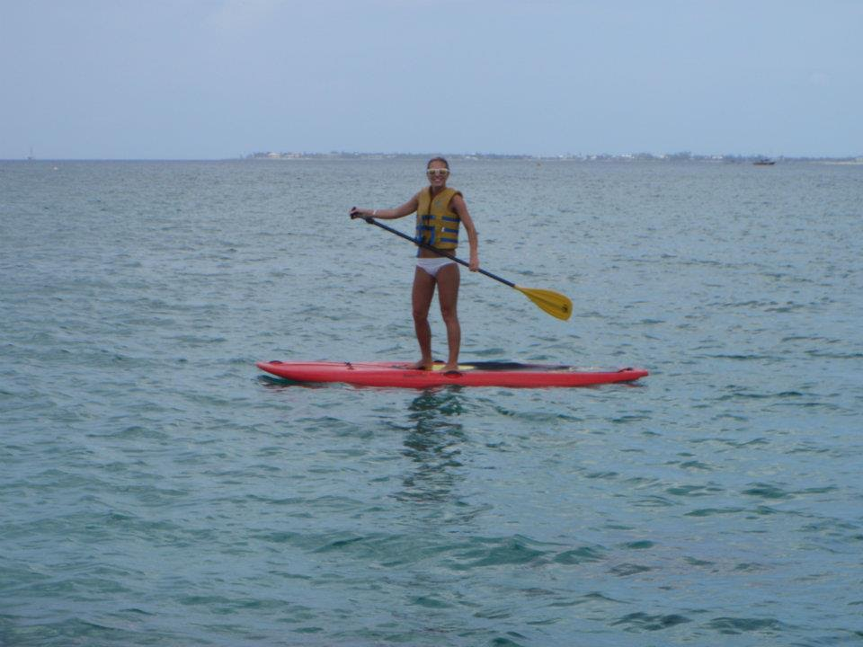 Keegan paddleboarding in Grand Cayman