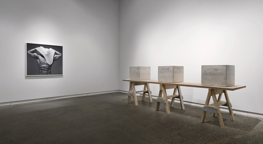 "Proud Flesh  (2011), cast concrete and glass, three objects; 18"" x 18"" x 18""   Beside Myself  (2011), chromogenic print; all prints are 40"" in height  Installation view of  Beside Myself  at Daniel Faria Gallery, Toronto, Canada"