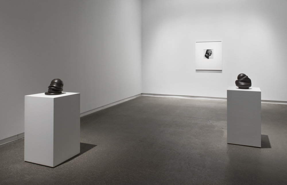 """Sixes and Sevens (2017) ceramic, sizes variable   Seem (2016) gelatin silver print, 12"""" x 12""""  Installation view of  Unruly Matter  at Daniel Faria Gallery, Toronto, Canada"""