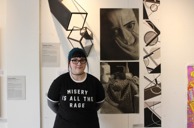 POD alum Hannah Falvey, now a freshmen at Rhode Island College, with her work at the first POD Alumni Exhibition