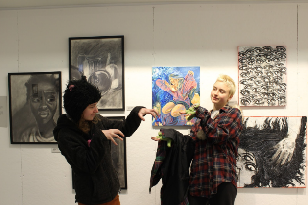 POD alum Zoe Anderson (left) with her work and sister and current POD teen Violet Anderson at the Alumni Exhibition