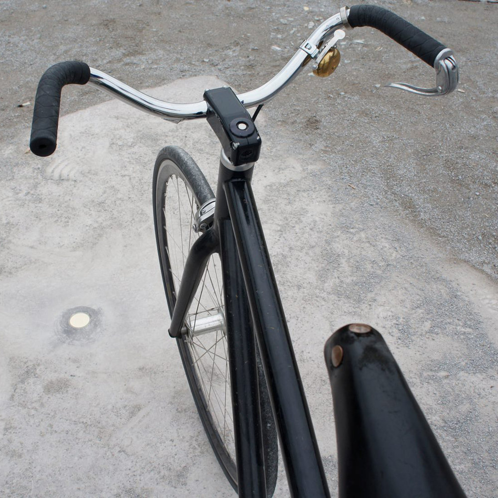"My trusty bike with me at Documenta ... standing over Walter De Maria's ""Vertical Earth Kilometer."""