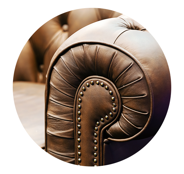 Detail at arm of leather sofa