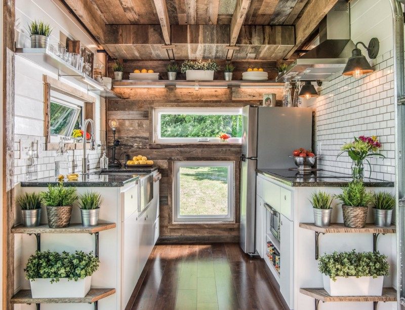 Kitchen. Nashville, Tennessee. Building and interior design by David Latimer for New Frontier Tiny Homes. Photography by StudiObuell. From the book  Your Creative Haven  by Donald M. Rattner (Skyhorse Publishing, 2019).