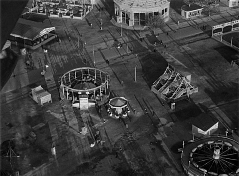 """TOP: The view from the top of the Ferris Wheel. The dark blips on the ground are called """"dots"""" by the Orson Welles character in the film. BOTTOM: At ground level, Joseph Cotten is easily identified at close proximity. Photographic stills from the 1949 film  The Third Man , directed by Sir Carol Reed."""
