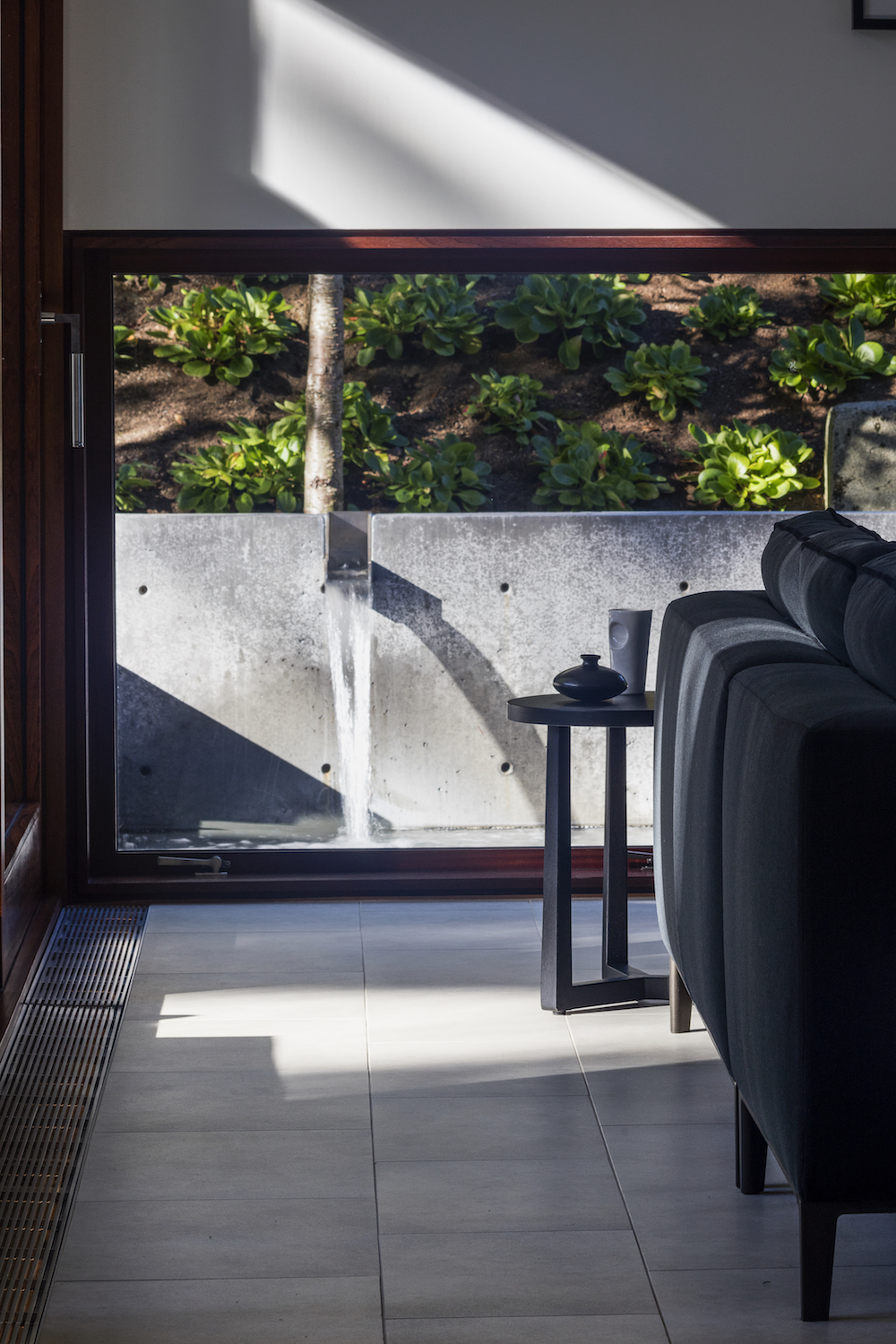 Living room and fountain details. Bellevue, Washington. Architecture by David Coleman Architecture. Interior design by Elizabeth Stretch for Stretch Design. Photography by Paul Warchol. From the book  Your Creative Haven  by Donald M. Rattner (2019).