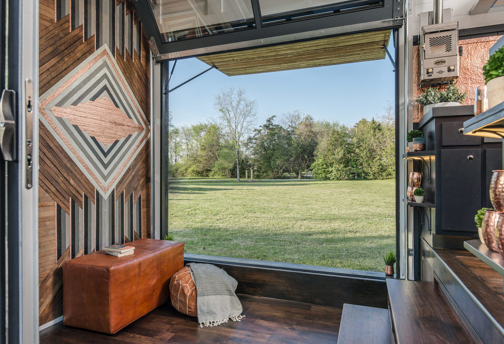 Living area. Nashville, Tennessee. Building and interior design by David Latimer for New Frontier Tiny Homes. Photography by StudiObuell. From the book  Your Creative Haven  (2019) by Donald M. Rattner.