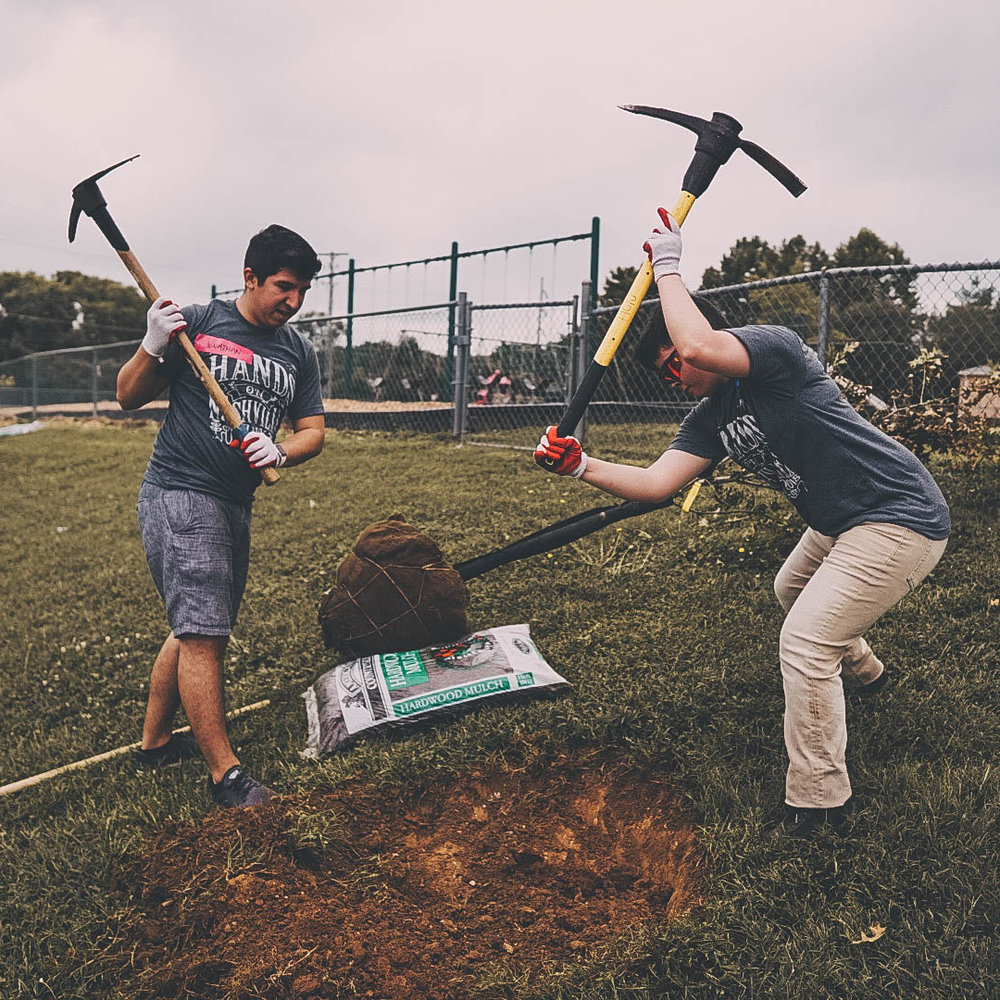 HCA volunteers plant trees at Hickman Elementary School.