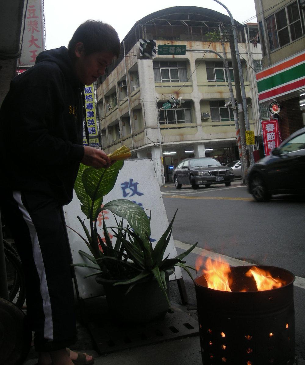 burning paper money.jpg
