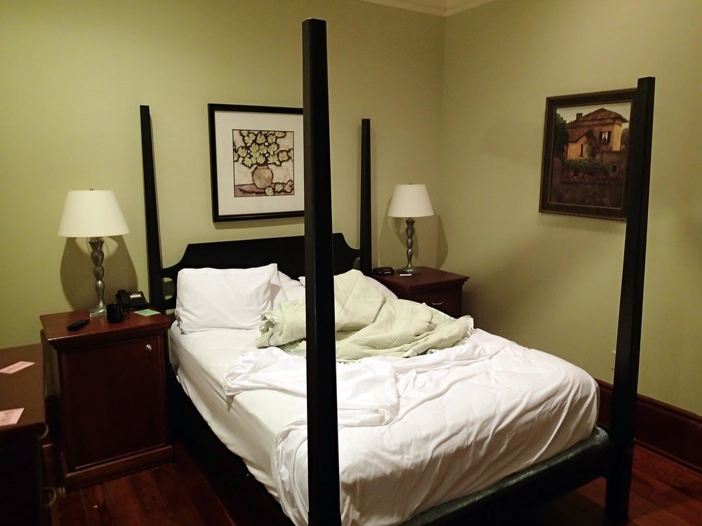Queen bed room at Prytania Oaks.jpg