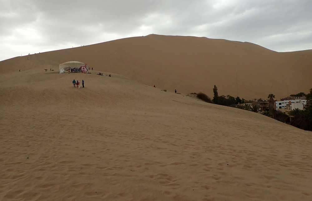 ascending the dunes behind town.jpg